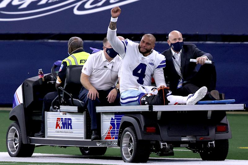 ARLINGTON, TEXAS - OCTOBER 11: Dak Prescott #4 of the Dallas Cowboys is carted off the field after sustaining a leg injury against the New York Giants during the third quarter at AT&T Stadium on October 11, 2020 in Arlington, Texas. (Photo by Tom Pennington/Getty Images)