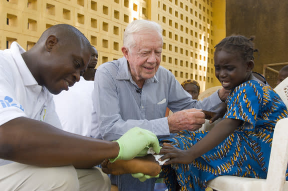 A 2007 photo of President Jimmy Carter as he tries to comfort Ruhama Issah, a 6-year-old girl in Ghana who had a Guinea worm. Ghana reported its last Guinea worm case in 2010.