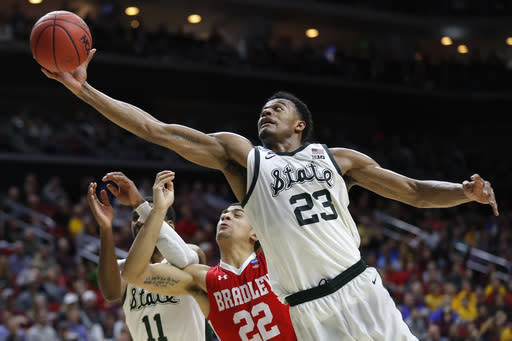 Michigan State forward Xavier Tillman (23) grabs a rebound over Bradley guard Ja'Shon Henry (22) during a first round men's college basketball game in the NCAA Tournament, Thursday, March 21, 2019, in Des Moines, Iowa. (AP Photo/Charlie Neibergall)