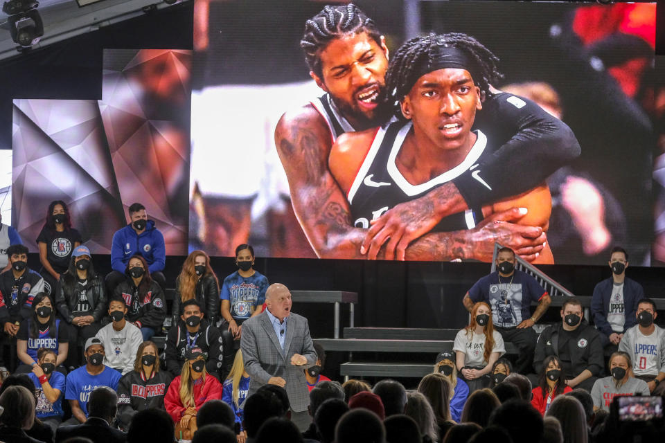 Los Angeles Clippers chairman Steve Ballmer speaks as a photo of Paul George and Terance Mann is shown on a screen during a groundbreaking ceremony of the Intuit Dome, Friday, Sept. 17, 2021, in Inglewood, Calif. The Clippers' long-awaited, $1.8 billion, the privately funded arena is officially named Intuit Dome. The practice facility, team offices for both business and basketball operations, retail space, and more will all be on the site when it opens in 2024. (AP Photo/Ringo H.W. Chiu)