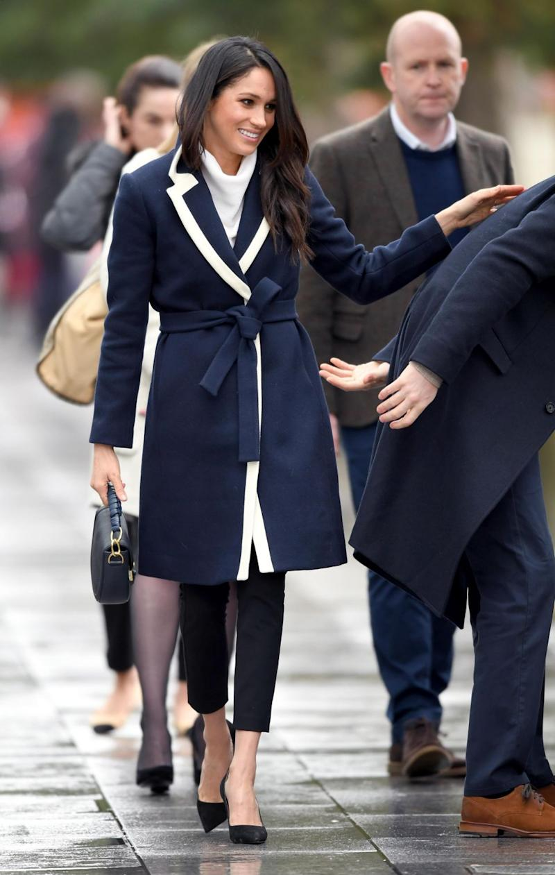 Meghan looked stunning in a J. Crew coat. Photo: Getty Images