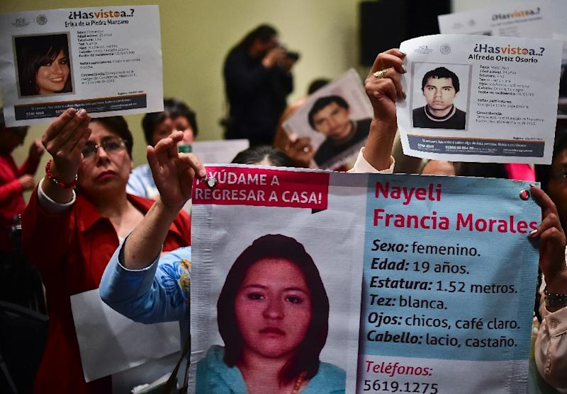 Relatives of missing demonstrate during a press conference by the Inter-American Commission on Human Rights, which visited Mexico from September 28 to October 2, 2015 to observe the country's human rights situation (AFP Photo/Ronaldo Schemidt)