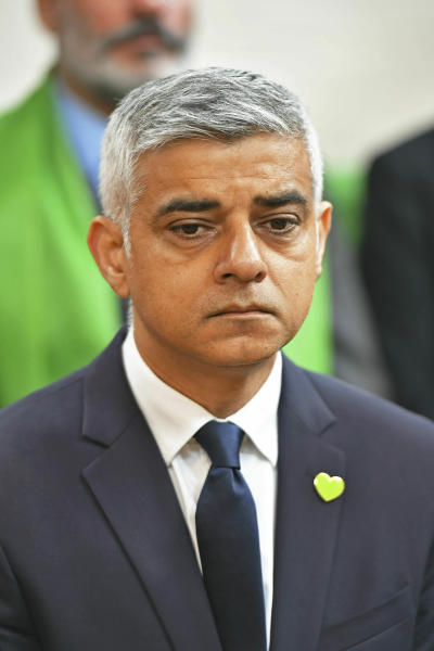 Mayor of London Sadiq Khan attends a service of remembrance at St Helen's church to mark the two-year anniversary of the Grenfell Tower apartment block fire, near to the site of the fire in London, Friday June 14, 2019.  Two years after the 24-storey tower-block fire that killed 72 people, campaigners say hundreds of apartment buildings remain at risk of a similar blaze. (Dominic Lipinski/PA via AP)