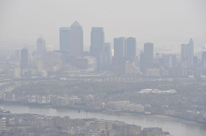 File photo dated 10/04/15 of air pollution over London. More than one in 19 deaths in UK towns and cities is linked to air pollution - and the figures are much worse for people living in the south, according to Centre for Cities charity.