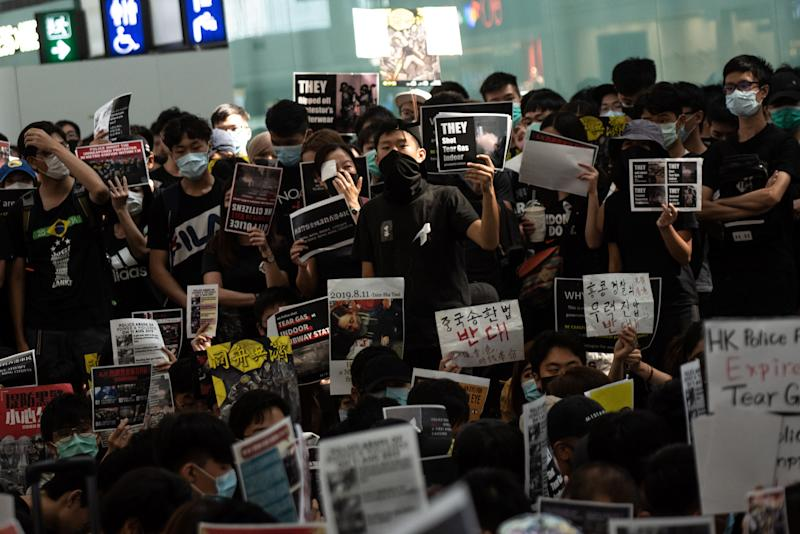 A group of pro-democracy protesters chant slogans outside the departures hall during another demonstration at Hong Kong's international airport on August 13, 2019. (Photo: Philip Fong/NurPhoto via Getty Images)