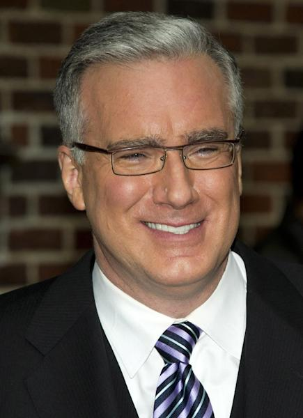 """FILE - In this Oct. 24, 2011 file photo, political pundit Keith Olbermann leaves a taping of the """"Late Show with David Letterman,"""" in New York. Current TV says it has ejected Keith Olbermann from its talk-show lineup after less than a year. The network announced late Friday afternoon that """"Countdown,"""" the show Olbermann has hosted since last June, was to be replaced with a show hosted by former New York Gov. Eliot Spitzer, beginning Friday night. (AP Photo/Charles Sykes, file)"""
