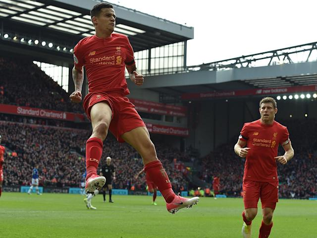 Philippe Coutinho leaps in celebration after scoring Liverpool's second goal against Everton: Getty