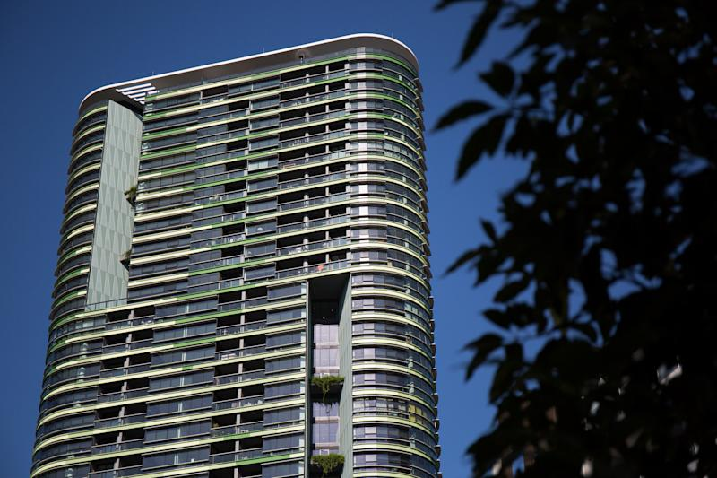 The Opal Tower building is seen at Sydney's Olympic Park, Thursday, May 23, 2019. The newly built block in Sydney Olympic Park was evacuated on Christmas Eve after cracks were found in the building, sparking fears it could collapse. (AAP Image/Paul Braven)
