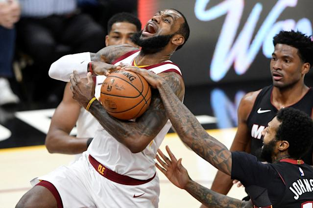 Jan 31, 2018; Cleveland, OH, USA; Cleveland Cavaliers forward LeBron James (23) drives to the basket beside Miami Heat forward James Johnson (16) and forward Justise Winslow (20) in the second quarter at Quicken Loans Arena. Mandatory Credit: David Richard-USA TODAY Sports TPX IMAGES OF THE DAY