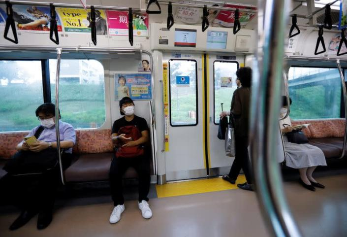 So Sato, a deaf and transgender pole vaulter, rides a train in Tokyo, Japan