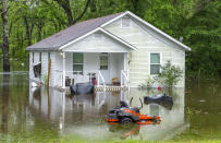 Water surrounds a house along flooded areas on Bluff Road Tuesday, May 18, 2021, in Ascension Parish, La. Heavy rains have swept across southern Louisiana, flooding homes, swamping cars and closing a major interstate. (Bill Feig/The Advocate via AP)
