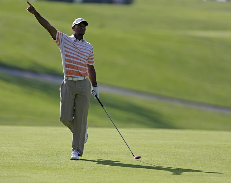 Tiger Woods points to direction of his second shot on the 11th hole during the second round of the Memorial golf tournament Friday, May 31, 2013, in Dublin, Ohio. (AP Photo/Darron Cummings)