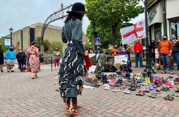 Jingle dancers performed while others formed a circle around the shoes, which symbolized the children buried in the unmarked graves in British Columbia.  (John Robertson/CBC - image credit)