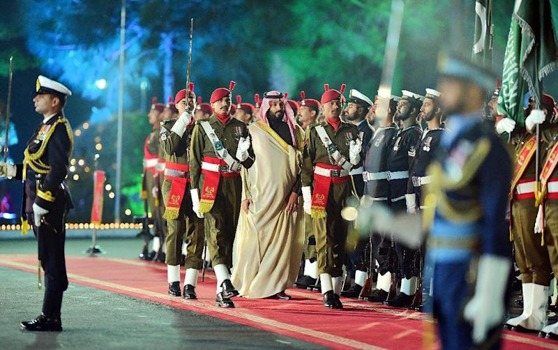 Saudi Arabian Crown Prince Mohammed bin Salman reviews a guard of honour at the Pakistan Prime Minister's House in Islamabad. Pakistan has rolled out the red carpet for the Saudi royal in exchange for economic deals worth over $20 billion (AFP Photo/HANDOUT)
