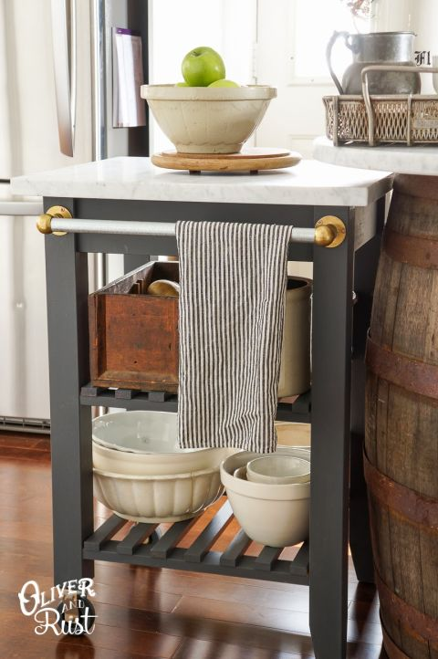 """<p>A fresh coat of gray paint, a chic marble top, and a shiny towel bar makes this kitchen helper as stylish as it is functional.</p><p>See more at <a href=""""https://www.oliverandrust.com/blog/ikea-hacking-in-the-kitchen-for-more-counter-space"""" rel=""""nofollow noopener"""" target=""""_blank"""" data-ylk=""""slk:Oliver and Rust"""" class=""""link rapid-noclick-resp"""">Oliver and Rust</a>.</p><p><em><a class=""""link rapid-noclick-resp"""" href=""""https://www.amazon.com/KILZ-TRIBUTE-Interior-Primer-8-Ounce/dp/B01NBHKC7B/?tag=syn-yahoo-20&ascsubtag=%5Bartid%7C2089.g.29514474%5Bsrc%7Cyahoo-us"""" rel=""""nofollow noopener"""" target=""""_blank"""" data-ylk=""""slk:BUY NOW"""">BUY NOW</a> <strong>Gray Paint, $50, <span class=""""redactor-unlink"""">amazon.com</span></strong></em></p>"""