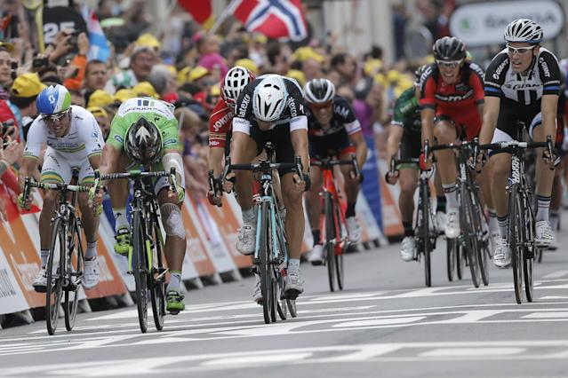 Italy's Matteo Trentin, third from left, crosses the finish line ahead of Peter Sagan of Slovakia, second left and second place, and Australia's Simon Gerrans, far left and fifth place, to win the seventh stage of the Tour de France cycling race over 234.5 kilometers (145.7 miles) with start in Epernay and finish in Nancy, France, Friday, July 11, 2014. Far right is fourth place Netherlands' Tom Dumoulin. (AP Photo/Christophe Ena)