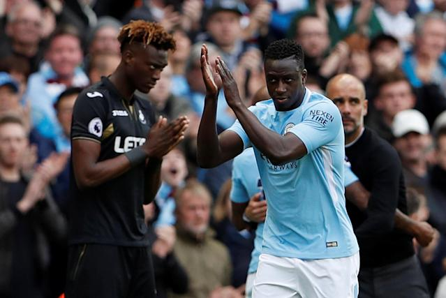 "Soccer Football - Premier League - Manchester City v Swansea City - Etihad Stadium, Manchester, Britain - April 22, 2018 Manchester City's Benjamin Mendy and Swansea City's Tammy Abraham prepare to come on as substitutes Action Images via Reuters/Lee Smith EDITORIAL USE ONLY. No use with unauthorized audio, video, data, fixture lists, club/league logos or ""live"" services. Online in-match use limited to 75 images, no video emulation. No use in betting, games or single club/league/player publications. Please contact your account representative for further details."