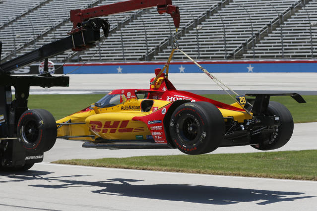 The car of Ryan Hunter-Reay is towed off the track after crashing during practice for the IndyCar auto race at Texas Motor Speedway in Fort Worth, Texas, Saturday, June 6, 2020. (AP Photo/Tony Gutierrez)