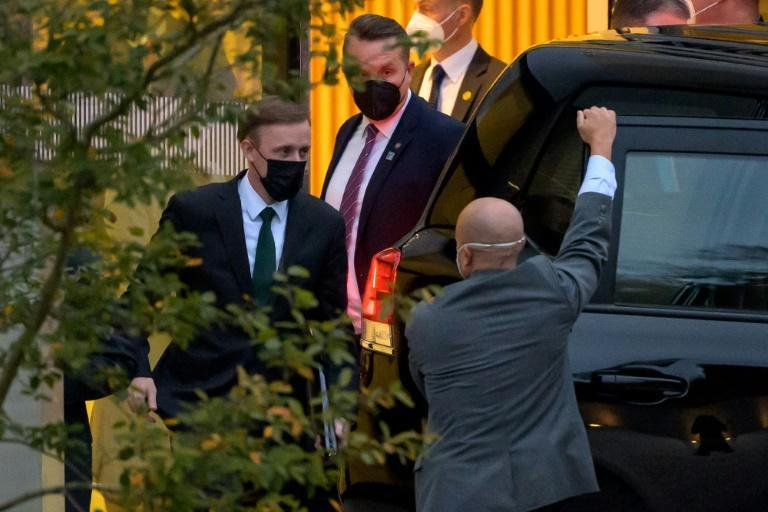 US National Security Advisor Jake Sullivan (L) leaves the Hyatt hotel in Zurich where top US and Chinese officials held talks on October 6, 2021 (AFP/Fabrice COFFRINI)