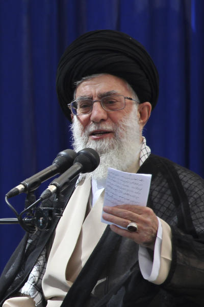 "Iranian supreme leader Ayatollah Ali Khamenei delivers a speech, during a ceremony marking 23rd death anniversary of the late revolutionary founder Ayatollah Khomeini, shown in the poster at right, at his mausoleum, just outside Tehran, Iran, Sunday, June 3, 2012. Iran's Supreme Leader warned Sunday that any Israeli attack would be answered with a ""lightning"" response by the Islamic Republic and suggested Iran's nuclear program cannot be curtailed by Western sanctions. (AP Photo/Mohammad Hassanzadeh, Fars News Agency)"