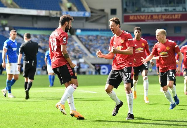 Manchester United's Bruno Fernandes (left) celebrates with Nemanja Matic after his last-gasp winner from the spot at Brighton