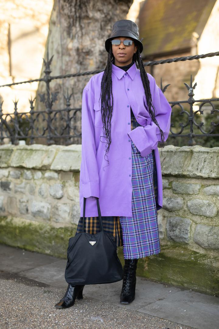 <p>A guest spotted out and about in London wearing an oversized shirt, matching bucket hat and Prada bag. <em>[Photo: Getty]</em> </p>