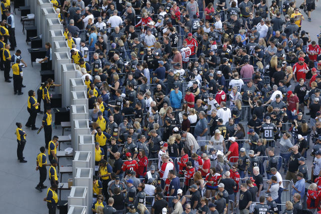 Fans wait to get in for Game 2 of the NHL hockey Stanley Cup Finals between the Vegas Golden Knights and the Washington Capitals on Wednesday, May 30, 2018, in Las Vegas. (AP Photo/Ross D. Franklin)