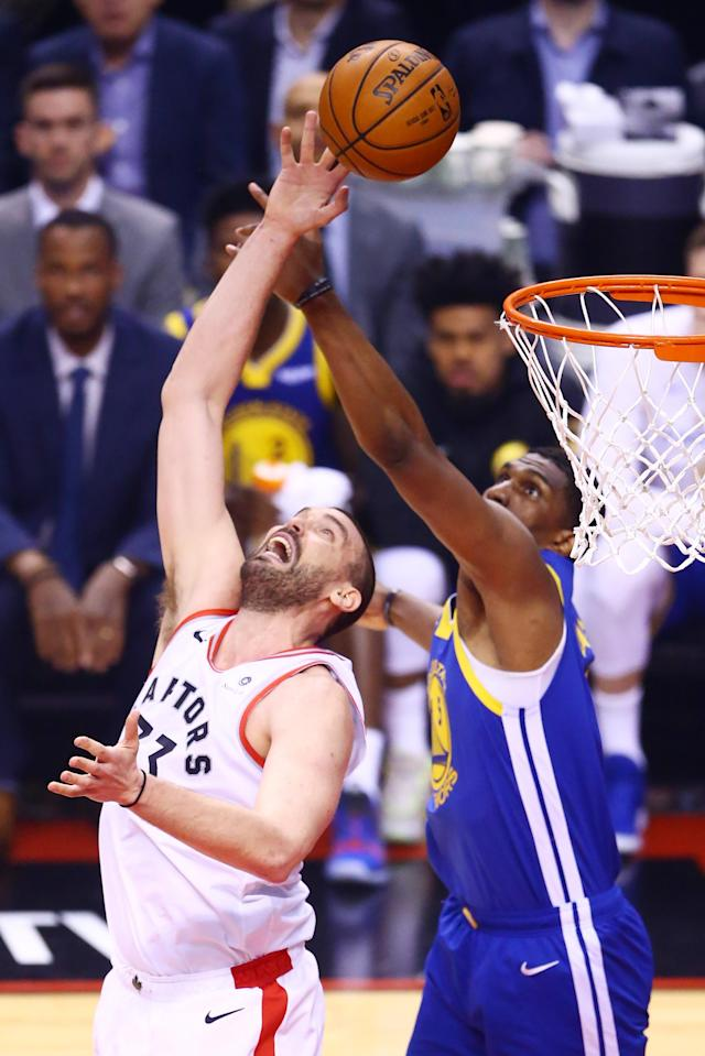 Marc Gasol #33 of the Toronto Raptors and Kevon Looney #5 of the Golden State Warriors battle for the rebound in the first quarter during Game One of the 2019 NBA Finals at Scotiabank Arena on May 30, 2019 in Toronto, Canada. (Photo by Vaughn Ridley/Getty Images)
