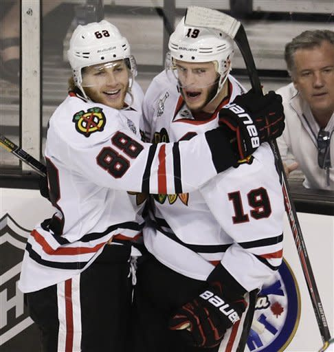Chicago Blackhawks center Jonathan Toews (19) celebrates his goal with Blackhawks right wing Patrick Kane (88) during the second period in Game 4 of the NHL hockey Stanley Cup Finals against the Boston Bruins, Wednesday, June 19, 2013, in Boston. (AP Photo/Charles Krupa)