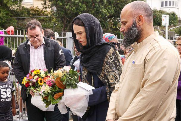 PHOTO: Prime Minister Jacinda Ardern lays flowers for victims of a mass shooting attack while finance minister Grant Robertson looks on at the Kilbirnie Mosque on March 17, 2019 in Wellington, New Zealand. (Hagen Hopkins/Getty Images)