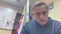 FILE PHOTO: Russian opposition leader Alexei Navalny speaks as he waits for a court hearing in a police station in Khimki