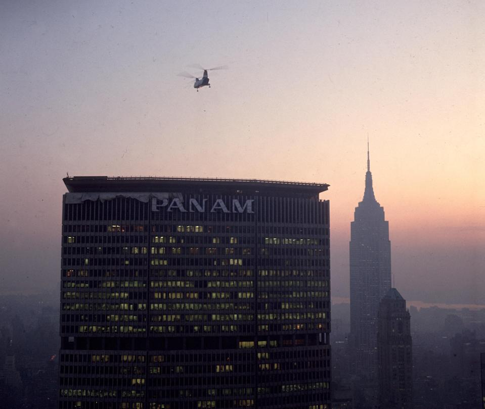 "A helicopter lands on the roof of the <a href=""https://www.cntraveler.com/story/how-pan-am-created-the-modern-economy-class?mbid=synd_yahoo_rss"" rel=""nofollow noopener"" target=""_blank"" data-ylk=""slk:Pan-Am"" class=""link rapid-noclick-resp"">Pan-Am</a> building (now the MetLife building), designed by German architect and Bauhaus founder Walter Gropius. Despite its collapse in 1991, Pan-Am shaped the way we fly today, by introducing economy class-seating and opening up air transportation to the masses."
