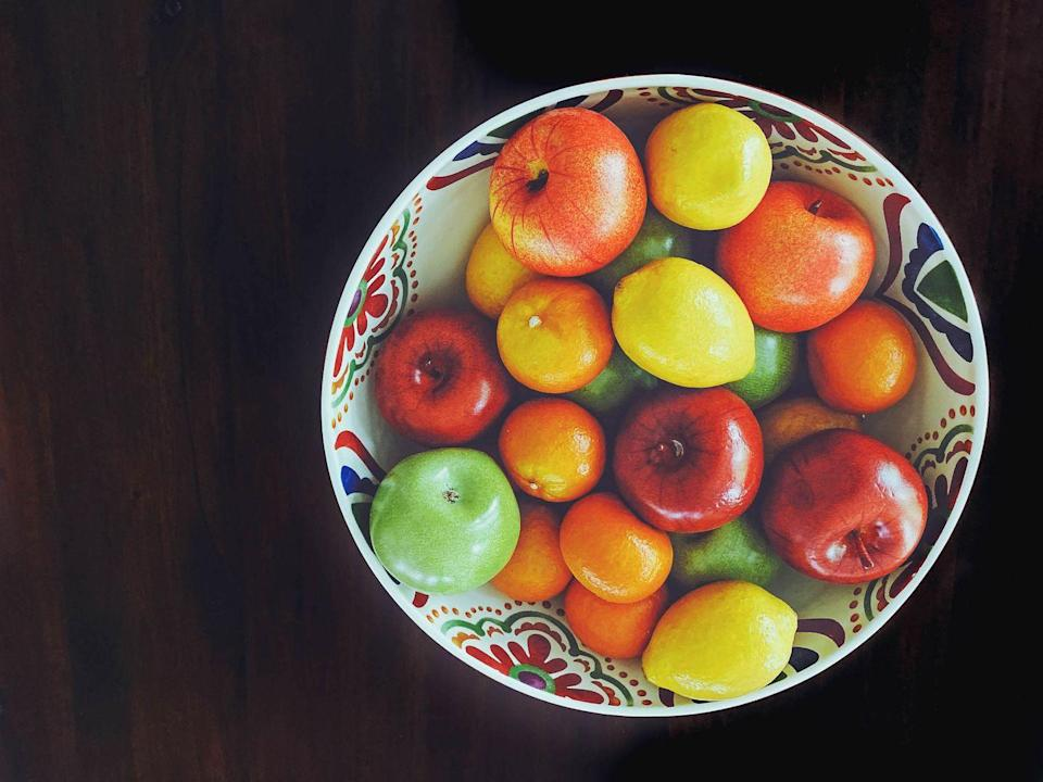 <p>Although there was something satisfying about pinching those rubber grapes throughout the 90s, the dust that collected on them wasn't as fun. Faux has been traded for fresh with the growing popularity of eating green and shopping local farmer's markets. </p>