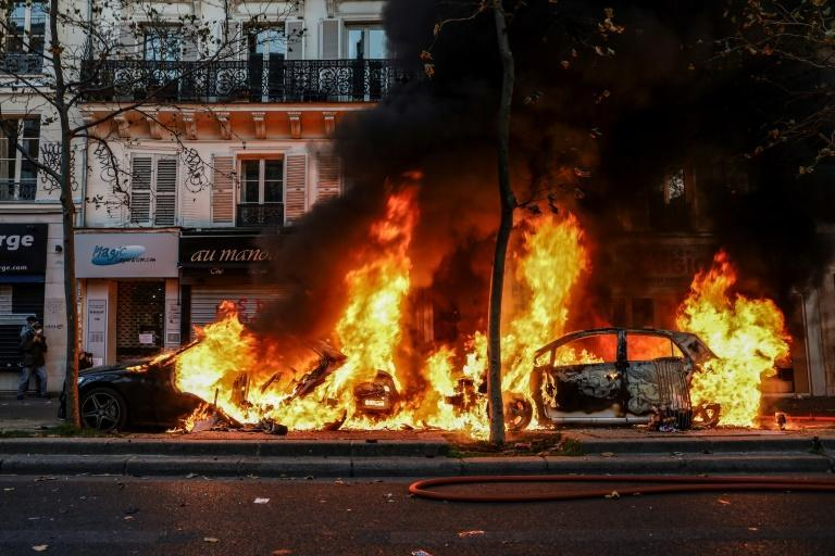 One of the pictures al-Halbi took in Paris on Saturday, showing vehicles set ablaze during a protest against a draft law which would allow prosecutions over the publication of images of on-duty police officers