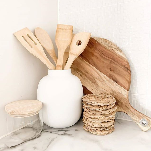 The store's cheap and chic homewares - such as these wooden utensils and woven coasters - have been a hit with influencers. Photo: Instagram/@myhomeofboho_luxe.