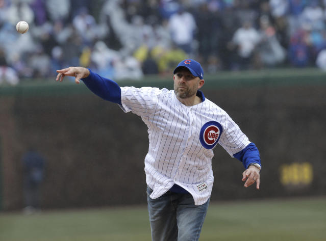 Chicago Bears head coach Matt Nagy throws the first pitch before Saturday's Cubs-Braves game at Wrigley Field. The Cubs would scored 11 unanswered runs after Nagy's seventh-inning stretch performance. (AP)