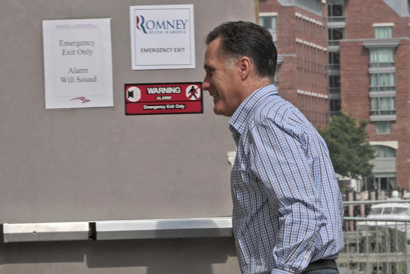 Republican presidential candidate, former Massachusetts Gov. Mitt Romney arrives at his campaign headquarters in Boston, Mass., Friday, Aug. 10, 2012. (AP Photo/Mary Altaffer)