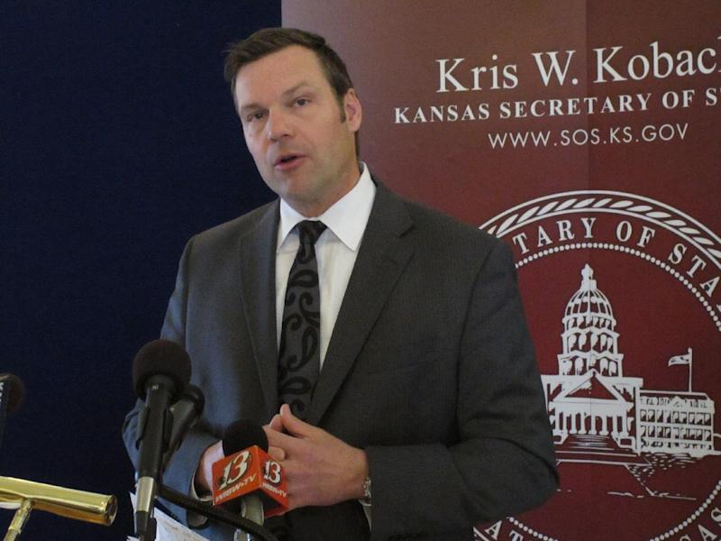 Kansas Secretary of State Kris Kobach answers questions from reporters during a news conference about a federal judge's ruling ordering the federal government to help Kansas and Arizona enforce their proof-of-citizenship requirements for new voters, Wednesday, March 19, 2014, in Topeka, Kan. Kobach and Arizona Secretary of State Ken Bennett filed a lawsuit over the issue. (AP Photo/John Hanna)