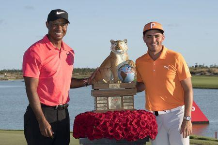 December 3, 2017; New Providence, The Bahamas; Tiger Woods (left) poses for a photo with winner Rickie Fowler (right) after the final round of the Hero World Challenge golf tournament at Albany. Mandatory Credit: Kyle Terada-USA TODAY Sports