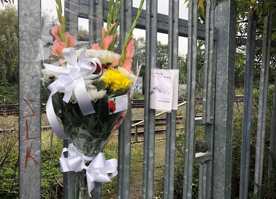 Flowers left at the scene where the boy was killed. (PA)