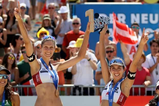 Canada's Sarah Pavan, left, and Melissa Humana-Paredes, right, pushed through tough quarter-final and semifinal matchups Thursday but manage to advance to the final at the four-star Katara Beach Volleyball Cup in Doha, Qatar.  (Ronald Zak/The Associated Press/File - image credit)