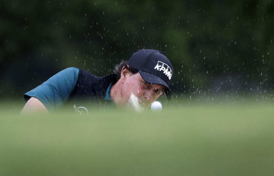 Phil Mickelson plays a shot from a bunker on the first hole during round-robin play at the Dell Technologies Match Play Championship golf tournament, Friday, March 29, 2019, in Austin, Texas. (AP Photo/Eric Gay)