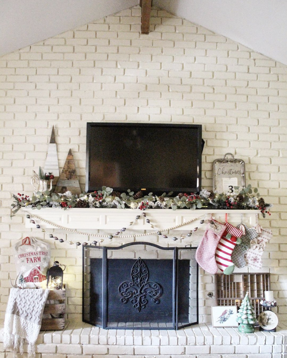 "<p>Just because you have a TV doesn't mean you have to forgo garland. To make it work, simply choose a thin, low-lying garland. Just pick one with a variety of accents, like berries and pinecones to ensure it doesn't look sparse. </p><p><em>See more at <a href=""https://www.instagram.com/fleurdelicia.decor/"" rel=""nofollow noopener"" target=""_blank"" data-ylk=""slk:fleurdelicia.decor"" class=""link rapid-noclick-resp"">fleurdelicia.decor</a>. </em></p><p><a class=""link rapid-noclick-resp"" href=""https://www.amazon.com/CraftMore-Brighton-Pine-Christmas-Garland/dp/B073R4PNBD/?tag=syn-yahoo-20&ascsubtag=%5Bartid%7C10072.g.34484299%5Bsrc%7Cyahoo-us"" rel=""nofollow noopener"" target=""_blank"" data-ylk=""slk:SHOP GARLAND"">SHOP GARLAND</a></p>"