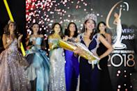 <p>Miss Universe Singapore 2018 Zahra Khanum walking the runway after receiving her tiara, sash and bouquet at the Miss Universe Singapore Grand Finale at One Farrer Hotel on 31 August 2018. (PHOTO: Don Wong for Yahoo Lifestyle Singapore) </p>