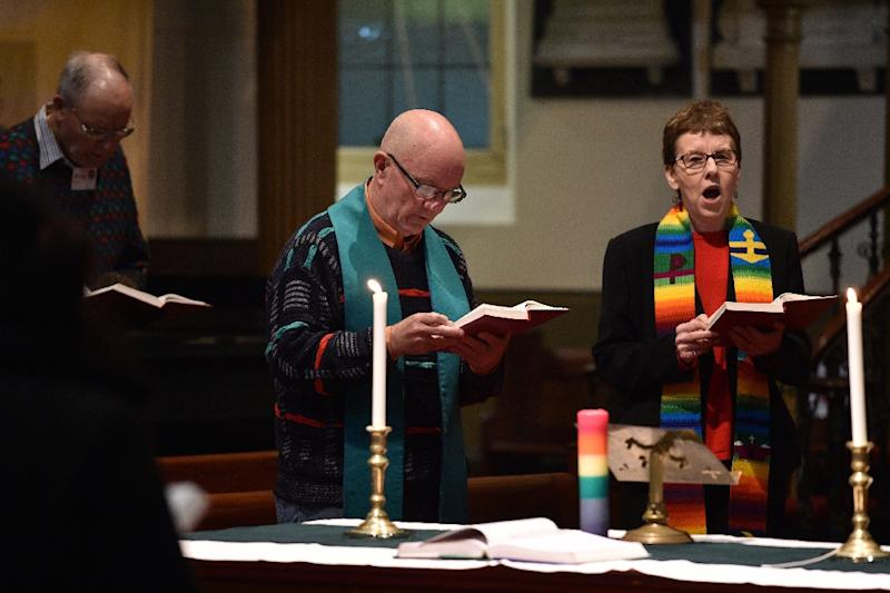 Reverend Margaret Mayman (R), minister of the Pitt Street Uniting Church, heads a Sunday service in Sydney (AFP Photo/Peter PARKS)