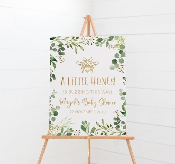 """<p><strong>LittleCreekCreative</strong></p><p>etsy.com</p><p><strong>$7.76</strong></p><p><a href=""""https://go.redirectingat.com?id=74968X1596630&url=https%3A%2F%2Fwww.etsy.com%2Flisting%2F736722242%2Fbee-baby-shower-a-little-honey-is-on-the&sref=https%3A%2F%2Fwww.womansday.com%2Flife%2Fg33138311%2Fbaby-shower-themes%2F"""" rel=""""nofollow noopener"""" target=""""_blank"""" data-ylk=""""slk:Shop Now"""" class=""""link rapid-noclick-resp"""">Shop Now</a></p><p>Celebrate the mom-to-'bee' with a sweet bee-themed shower. You can buy or DIY a honeycomb wall hanging or table runner, serve some <a href=""""https://www.youtube.com/watch?v=AZ_zNponeq4"""" rel=""""nofollow noopener"""" target=""""_blank"""" data-ylk=""""slk:beehive cupcakes"""" class=""""link rapid-noclick-resp"""">beehive cupcakes</a>, and send everyone home with <a href=""""https://www.amazon.com/Homestead-Honey-Unfiltered-American-Original/dp/B07KKPWYGT/ref=sr_1_5"""" rel=""""nofollow noopener"""" target=""""_blank"""" data-ylk=""""slk:honey sticks"""" class=""""link rapid-noclick-resp"""">honey sticks</a> or <a href=""""https://www.amazon.com/Mmei-Portable-Wooden-Dispense-Drizzle/dp/B01M0IRZQT/ref=sr_1_7"""" rel=""""nofollow noopener"""" target=""""_blank"""" data-ylk=""""slk:stirrers"""" class=""""link rapid-noclick-resp"""">stirrers</a> as favors. </p>"""