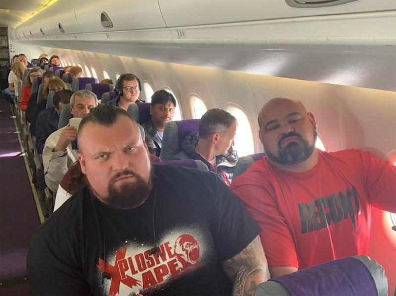Two World's Strongest Man Champions Squeeze in Next to Each Other on a Plane