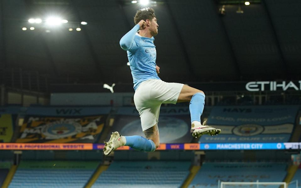 John Stones celebrates after making it 1-0 to Manchester City - NMC POOL
