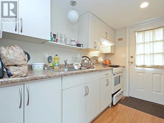 <p><span>2804 Cook St., Victoria, B.C.</span><br> There are three independent suites in the home, currently bringing in $42,300 in income for the owner annually.<br> (Photo: Zoocasa) </p>