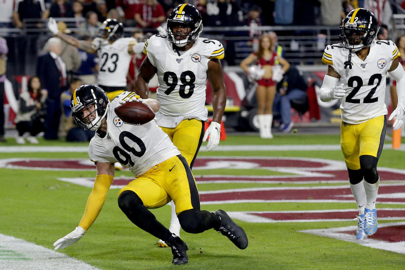 Pittsburgh Steelers outside linebacker T.J. Watt (90) celebrates his interception in the end zone against the Arizona Cardinals during the second half of an NFL football game, Sunday, Dec. 8, 2019, in Glendale, Ariz. (AP Photo/Rick Scuteri)